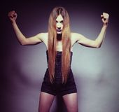 Woman long hair make-up shows her muscles Stock Photos