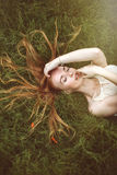 Woman with long hair in nature Stock Images