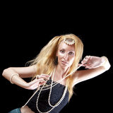 Woman with long hair and a pearl beads on dark background. Royalty Free Stock Image