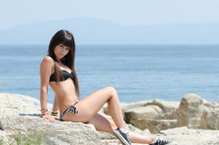 Woman with long hair and prefect slim body in bikini Royalty Free Stock Photography