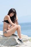 Woman with long hair and prefect slim body in bikini Stock Image
