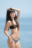 Woman with long hair and prefect slim body in bikini Stock Images