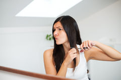 Woman with long hair preparing to cut it Royalty Free Stock Image