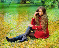 Woman with long hair rest in autumn park. Royalty Free Stock Photography