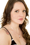 Woman with long hair and rose tattoo on shoulder close looking Royalty Free Stock Image