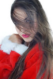 Woman with long hair in Santa costume Royalty Free Stock Photography