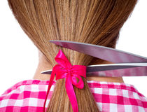 Woman with long hair and scissors cutting Stock Photo