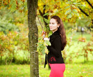 Woman with long hair in summer park Royalty Free Stock Photos