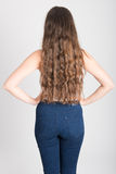 Woman with long hair wearing white t-shirt and blue jeans Royalty Free Stock Photo
