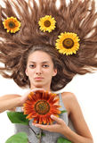 Woman with long hairs and sunflower Stock Photo