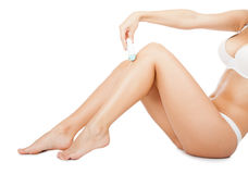 Woman long leg shaving. With electric shaver hair remover Stock Photos