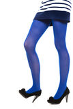 Woman long legs and blue stockings isolated Royalty Free Stock Photo