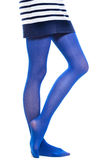 Woman long legs and blue stockings isolated Stock Photo