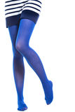Woman long legs and blue stockings isolated Royalty Free Stock Photography