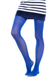 Woman long legs and blue stockings isolated Royalty Free Stock Photos