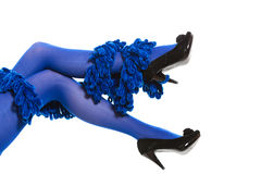 Woman long legs and blue stockings isolated Royalty Free Stock Images
