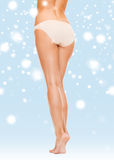 Woman with long legs in cotton underwear Royalty Free Stock Photography