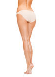 Woman with long legs in cotton underwear Stock Image