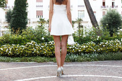 Woman with long legs going to hotel in summer dress Royalty Free Stock Photo