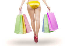 Woman long legs holding shopping bags Royalty Free Stock Photography