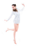 woman with long legs jumping. Isolated on white background Stock Photography