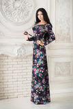 Woman in long maxi dress in studio Stock Images
