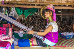 Kayan girl with loom Stock Images
