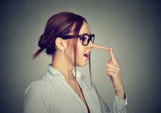 Woman with long nose. Liar concept. Stock Photo