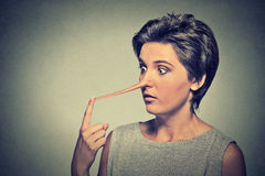 Woman with long nose. Liar concept Stock Photography