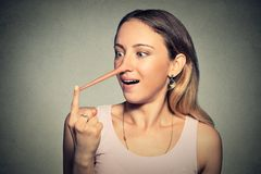 Woman with long nose. Liar concept. Royalty Free Stock Photo