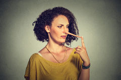 Woman with long nose. Liar concept. Royalty Free Stock Images