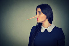 Woman with long nose. Liar concept. Stock Photography