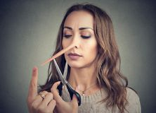 Woman with long nose and scissors Stock Images
