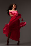 Woman in a long pink dress Stock Images