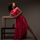 Woman in a long pink dress Stock Image