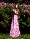 Woman in long pink dress with flowers Royalty Free Stock Images