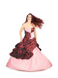 Woman in long pink dress with flying hair Royalty Free Stock Photo