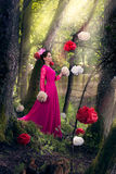 Woman in long pink dress Stock Image