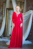 Woman in long red dress. Luxury interior Stock Photography