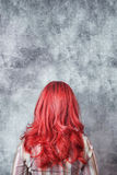 Woman with long red hair Stock Images