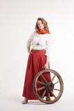 Woman in long red skirt  standing near wheel of Stock Photos