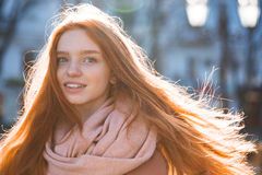 Woman with long redhead hairs standing outdoors. Portrait of a happy woman with long redhead hairs standing outdoors Stock Images