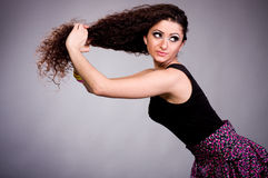Woman with long ringlets hair Stock Photography