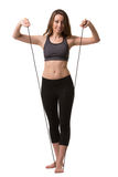 A woman with a long skipping-rope. Royalty Free Stock Photo