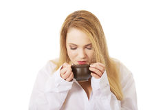 Woman in long sleeve shirt drinking coffee. Royalty Free Stock Photo