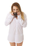 Woman in long sleeve shirt drinking coffee. Stock Photos