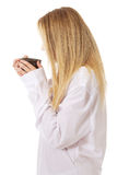 Woman in long sleeve shirt drinking coffee. Royalty Free Stock Images