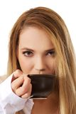 Woman in long sleeve shirt drinking coffee. Royalty Free Stock Image