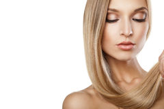 Woman with long straight blond hairs isolated Stock Photos