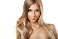 Woman with long straight blond hairs isolated Stock Photography